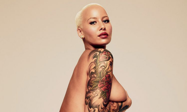 Amber Rose holding her breast