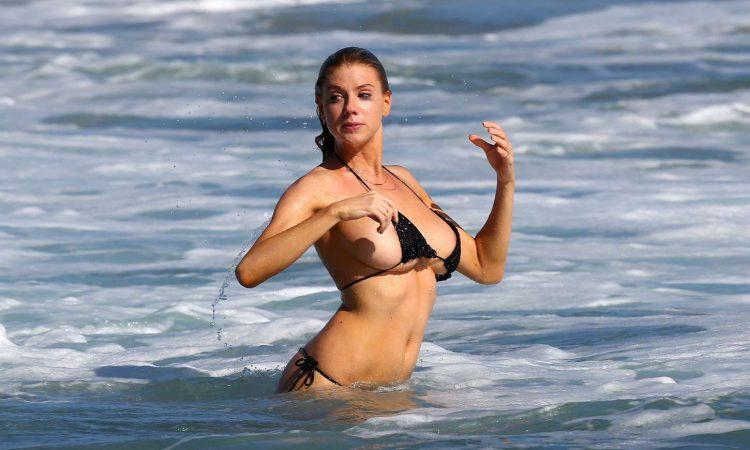 Charlotte McKinney in black bikini top
