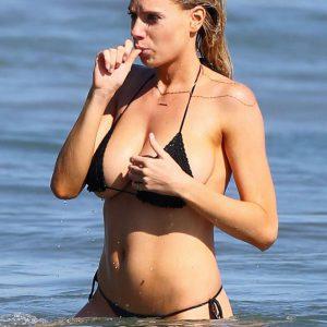 Charlotte McKinney tits in black bikini top sucking finger