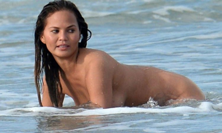 Chrissy Teigen in the ocean with no clothes on