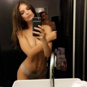 em rata takes topless selfie in thong
