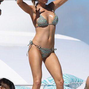 Joanna Krupa dancing and peace signs