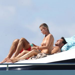 Joanna Krupa sitting on a yacht with tits out