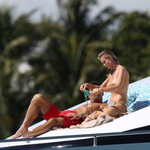 Joanna Krupa topless adjusting her bikini top