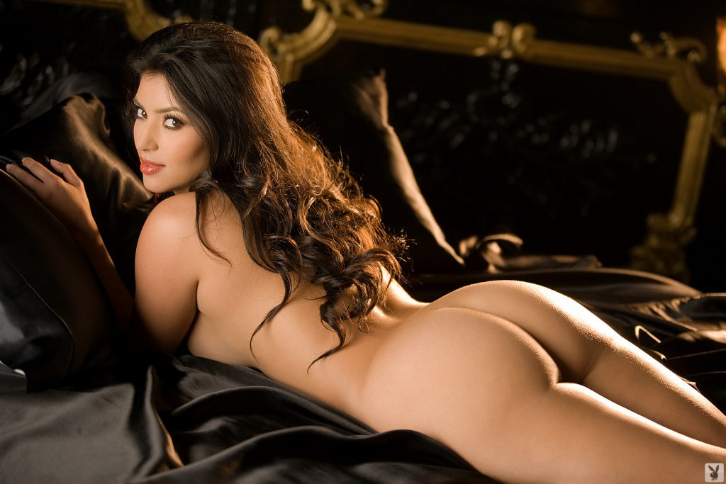 Kim's big ass showing while she is nude on bed with black sheets