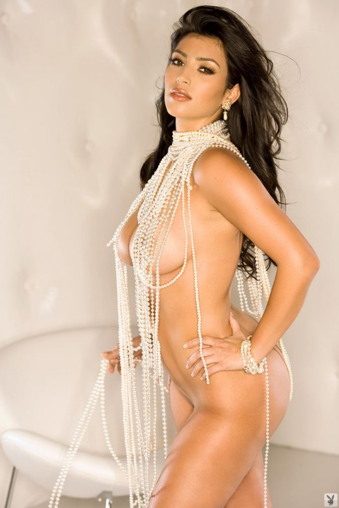 kim kardashian with pearls around her neck and nipples exposed