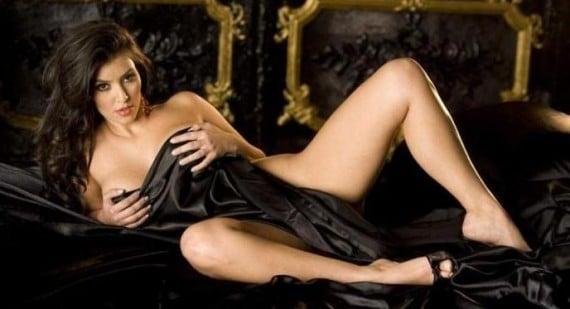 kim kardashian covers her body with black sheet