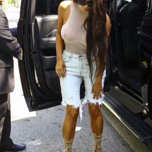 Kim Kardashian nipples visible as she is getting out of vehicle in NYC