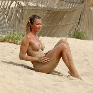 nell mcandrews totally naked on the beach with sand on her body