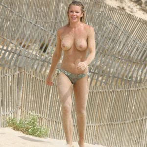 nell mcandrews topless on the beach with sand all over her body