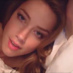 Amber Heard laying in bed