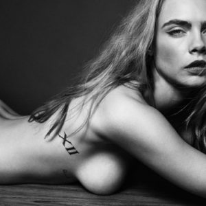 up close of Cara Delevingne's naked topless body for Esquire magazine