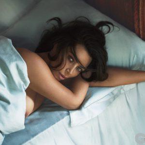 nip exposed of kim kardashian laying in bed