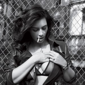 social media queen kim kardashian smoking a cig in modeling pic