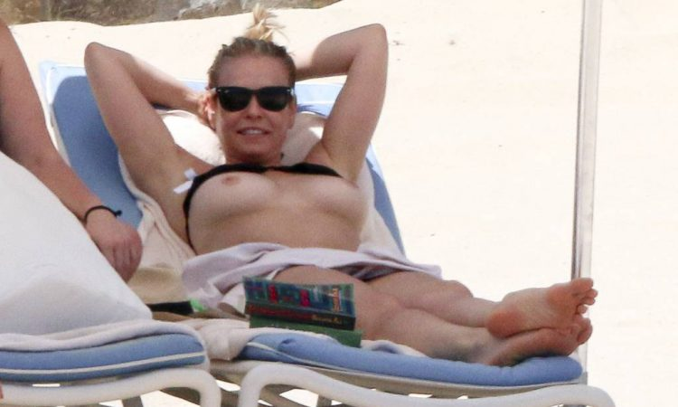Chelsea Handler topless breasts on the beach