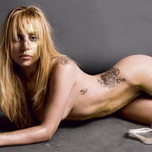 singer lady gaga completely naked laying on the ground