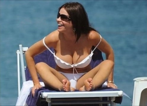 Sofia Vergara and her big boobs by the ocean in white bikini