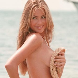 yummy pic of sofia vergara covering boobs with hat on beach