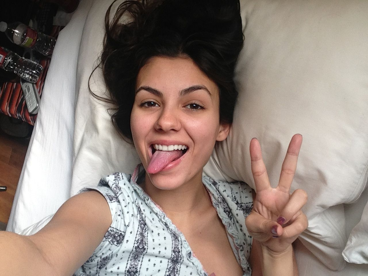 sexy victoria justice sticking out her tongue in hot selfie while laying in bed