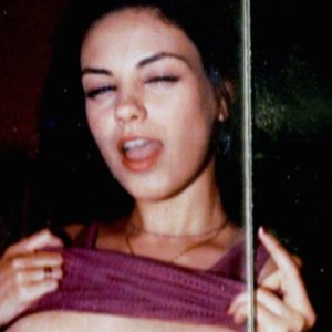 sexy pic of mila kunis topless with her mouth opened and pulling up her shirt