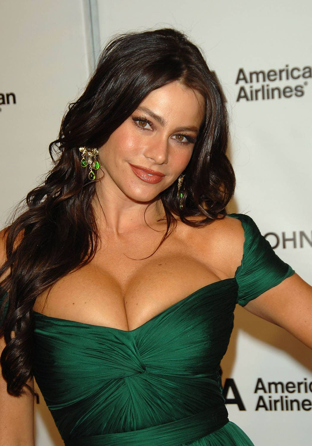 sofia vergara has cleavage popping out of green dress