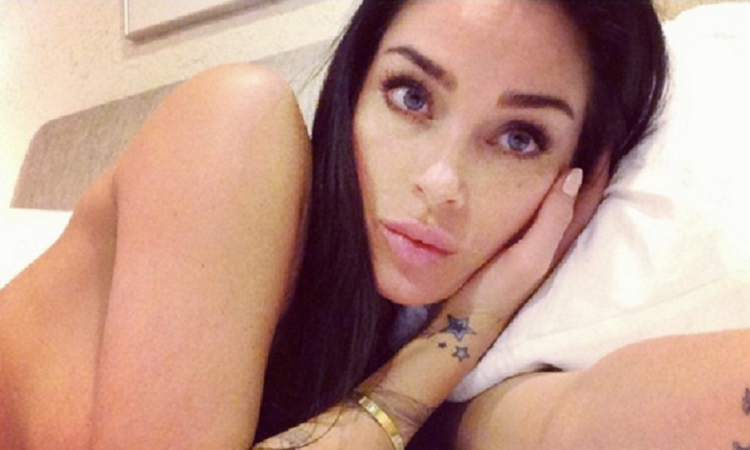 selfie pic of jasmine waltz in bed topless and covering her boobs with her arms