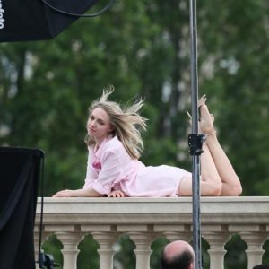gorgeous pic of amanda seyfried laying on paris balcony with legs in the air and her hair blowing in the wind
