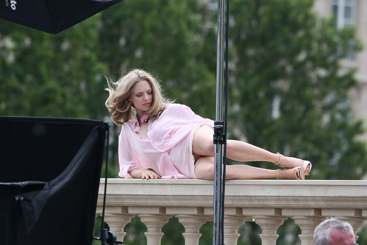 celeb amanda seyfriend modeling in paris with a skirt on and heels