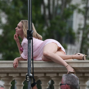 upskirt pic of amanda seyfried laying on balcony with heels on