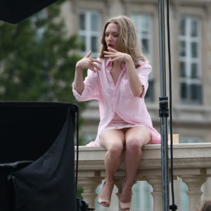 the beautiful amanda seyfried sitting on a balcony in paris with crotch shot exposed