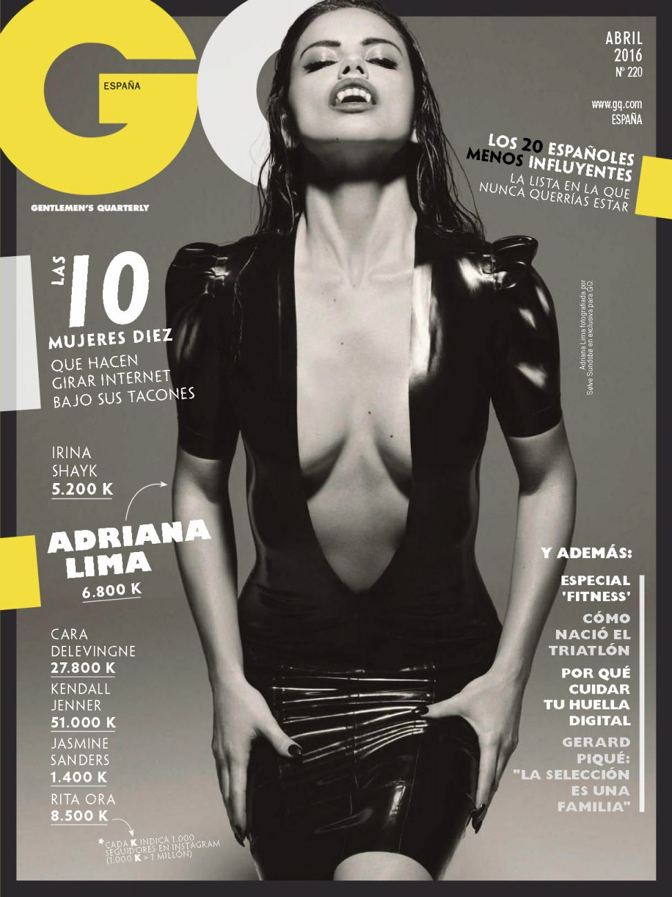 GQ magazine cover of Adriana Lima in black dress showing cleavage with vampire teeth