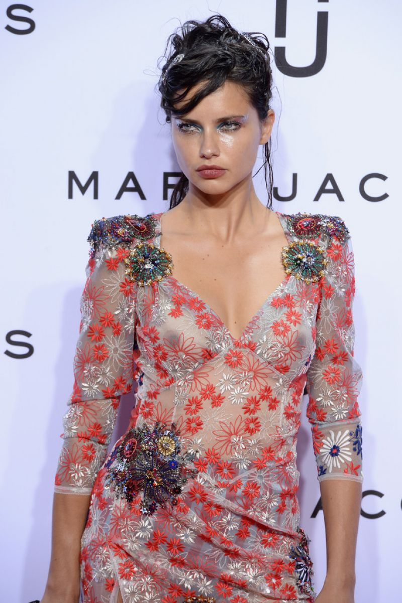 Adriana Lima in a floral gown with her nipples visible