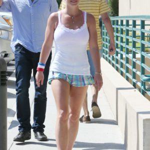 Singer Britney Spears in white tank top and shorts