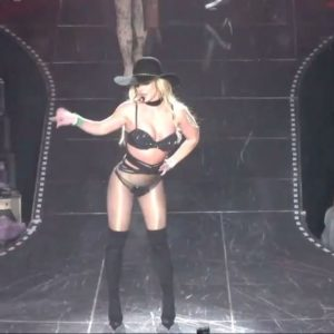 Britney Spears in a cowboy hat and high thigh boots