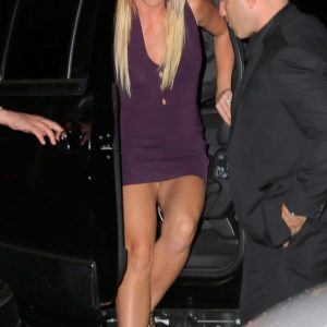 Britney Spears flashes her vagina while wearing tight purple dress