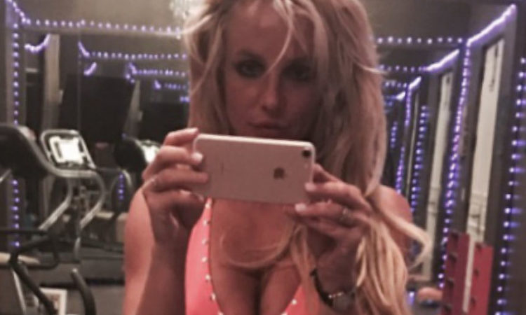 Britney Spears taking a selfie showing off her cleavage