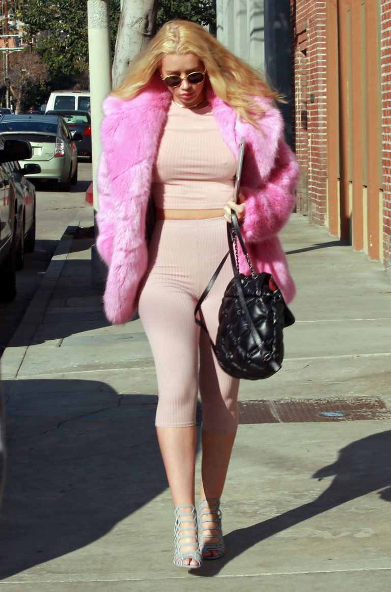 Iggy Azalea in pink outfit without bra