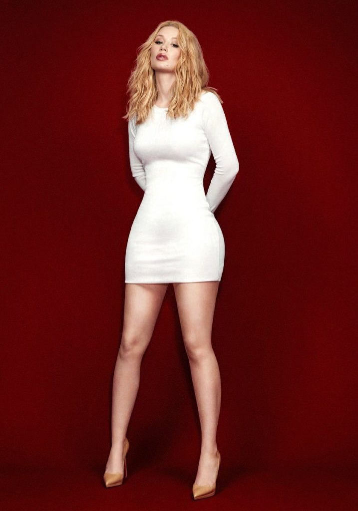 Iggy Azalea in a white dress showing off her big curves