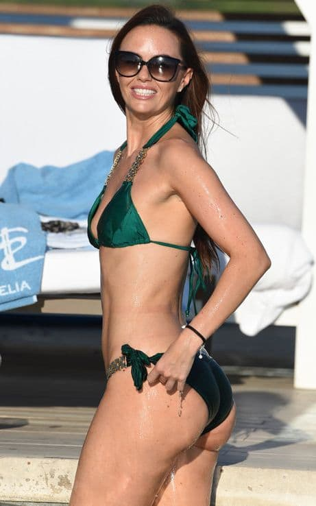 Jennifer Metcalfe wearing shiny green two piece
