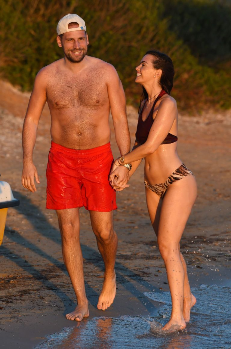 Jennifer Metcalfe with boyfriend Greg Lake in swimsuits holding hands