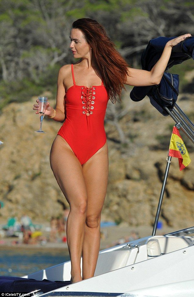 Jennifer Metcalfe in red one piece swimsuit on a boat.