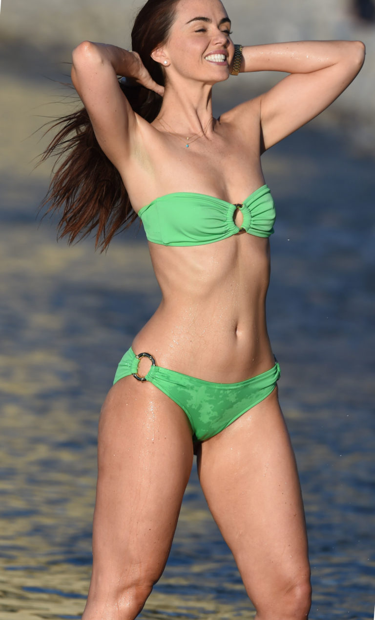 Jennifer Metcalfe's body in lime green bikini pulling back her hair