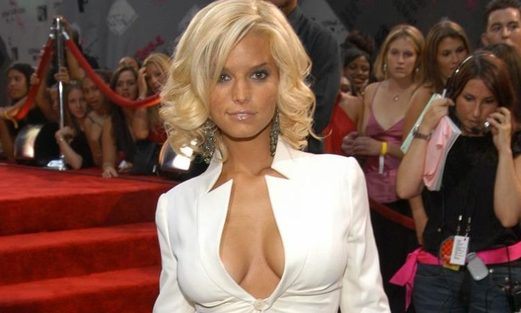 Jessica Simpson with short blonde hair and showing her tan tits in white jacket