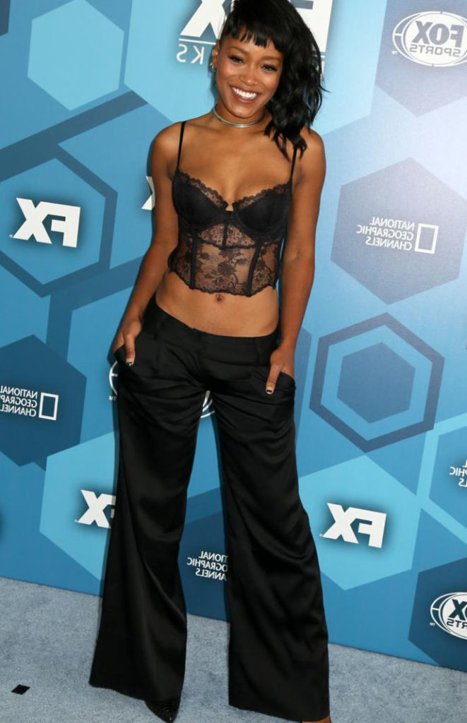 Keke Palmer in lacy black corset and long black pants