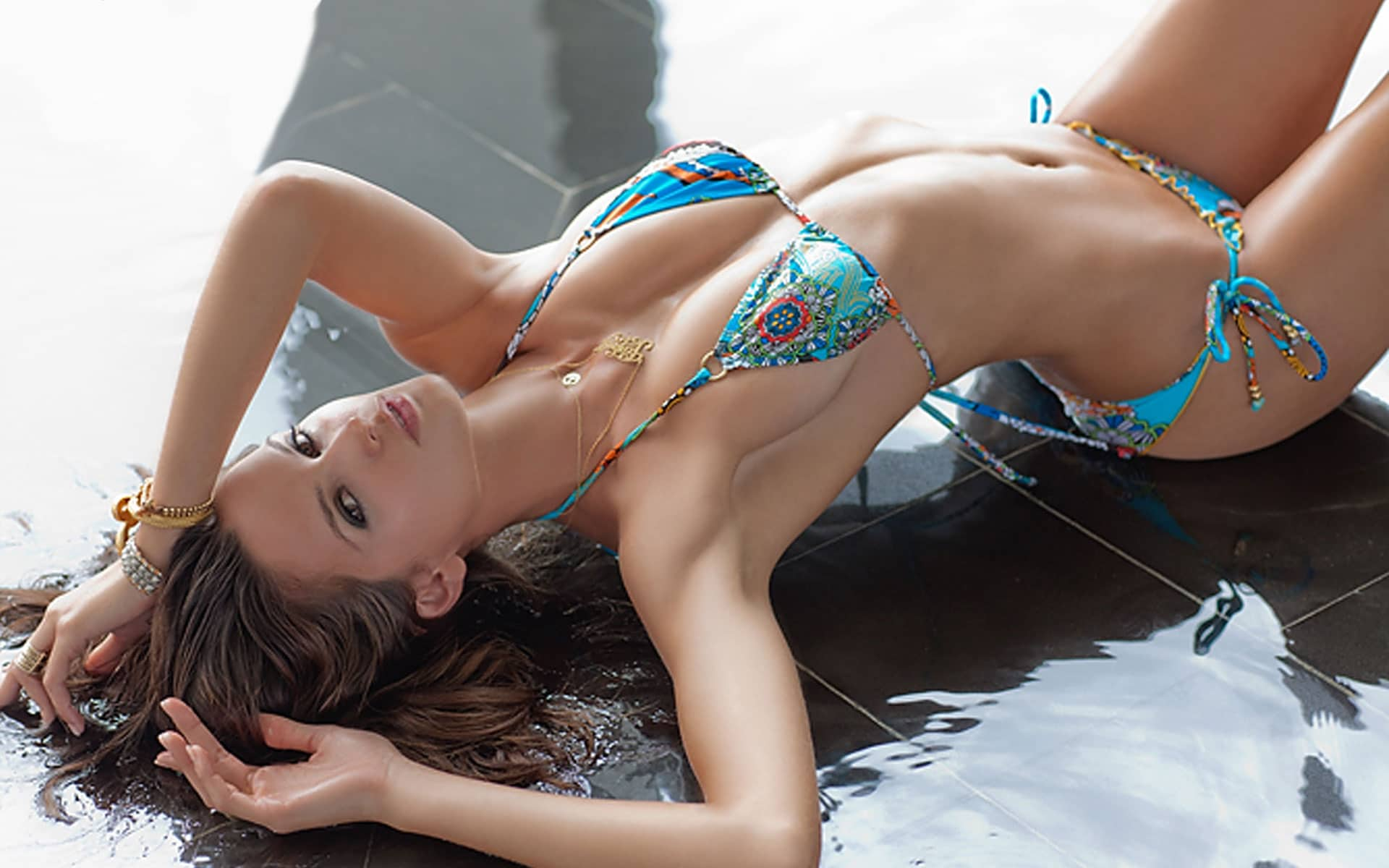 Izabel Goulart for Sports Illustrated magazine modeling a bikini on the floor